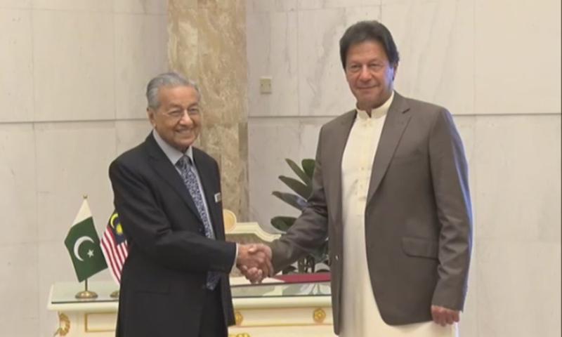 Malaysian Prime Minister Mahathir Mohamad greets Prime Minister Imran Khan in Putrajaya on Tuesday. — DawnNewsTV