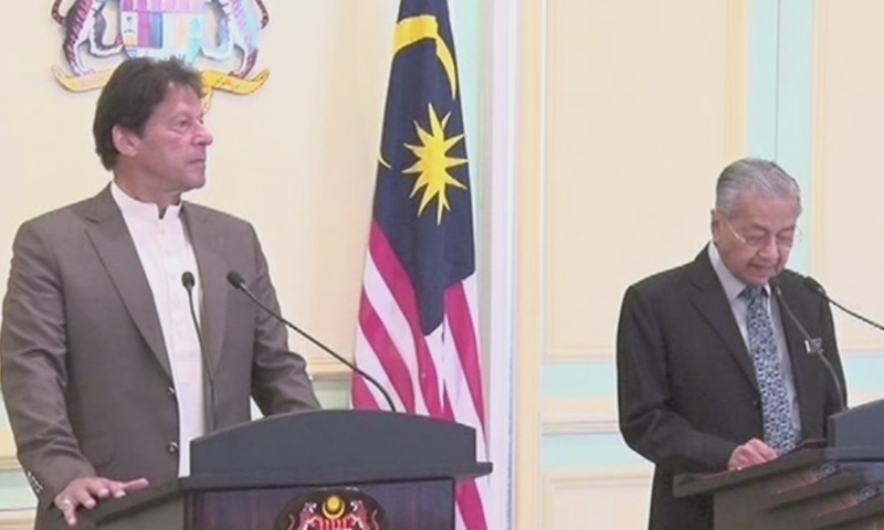 Prime Minister Imran Khan and Malaysian Prime Minister Mahathir Mohamad address a joint press conference on Tuesday. — DawnNewsTV