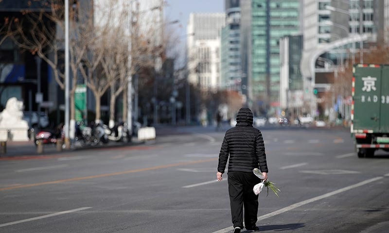 A man walks along the Financial Street in central Beijing, China, as the country is hit by an outbreak of the new coronavirus, on February 3. — Reuters