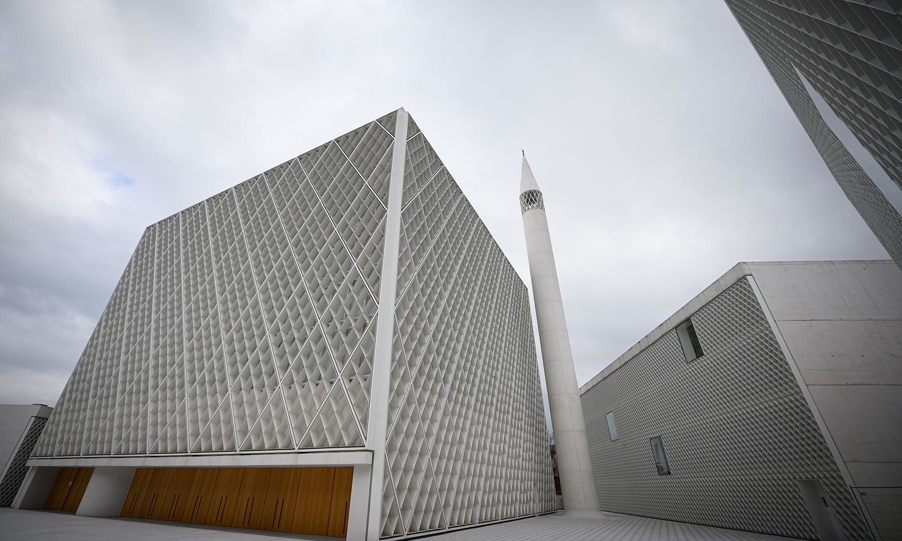 This picture shows the minaret and buildings of Slovenia's first mosque, designed by the Bevk Perovic Arhitekti architecture firm, in Ljubljana. — AFP