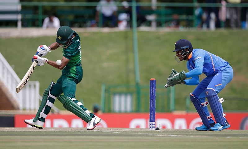 Pakistan's Fahad Munir (L) plays a shot as India's Dhruv Jurel (R) looks on during the Semi-Final of the ICC Under-19 Cricket World Cup between India and Pakistan at the Senwes Park in Potchefstroom on February 4, 2020. — AFP