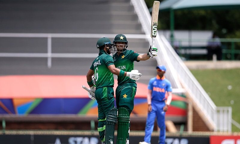 Haider Ali (R) is congratulated by captain Rohail Nazir after scoring a half-century. — AFP