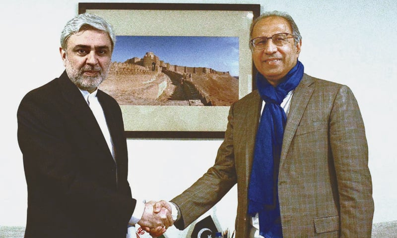 Adviser to the Prime Minister on Finance and Revenue Abdul Hafeez Shaikh with Iranian Ambassador to Pakistan Mohammad Ali Hosseini at the Finance Division on Tuesday. During their meeting, the adviser said Pakistan wanted to expand bilateral trade with Iran.—APP