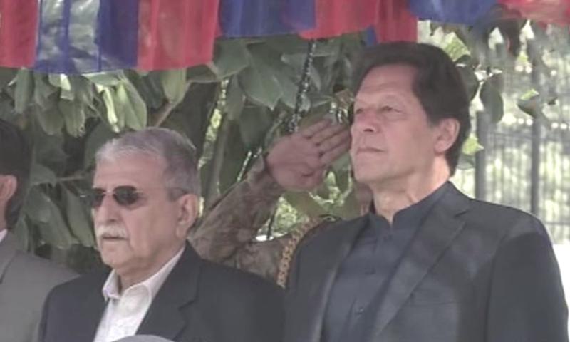 Prime Minister Imran Khan stands alongside Prime Minister of Azad Jammu & Kashmir Raja Muhammad Farooq Haider Khan in Muzaffarabad on Wednesday.  — DawnNewsTV