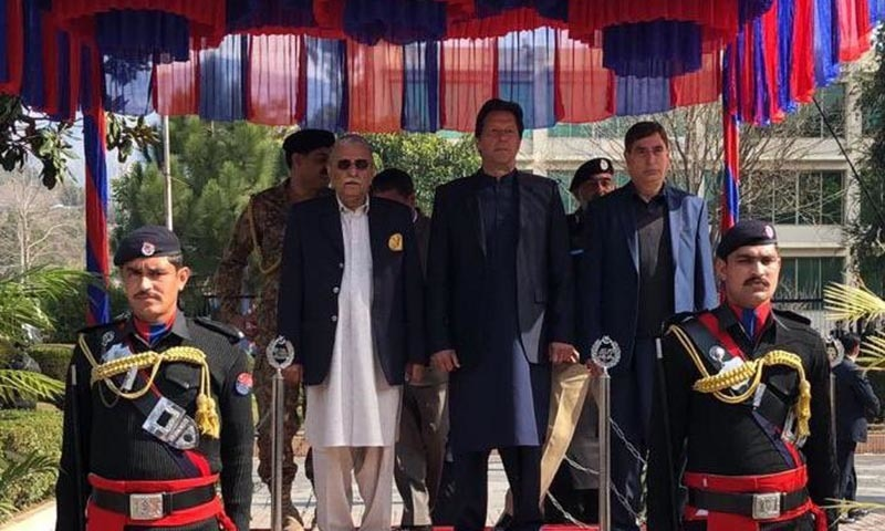 Prime Minister Imran Khan stands alongside Prime Minister of Azad Jammu & Kashmir Raja Muhammad Farooq Haider Khan in Muzaffarabad on Wednesday.  — PM Office Twitter