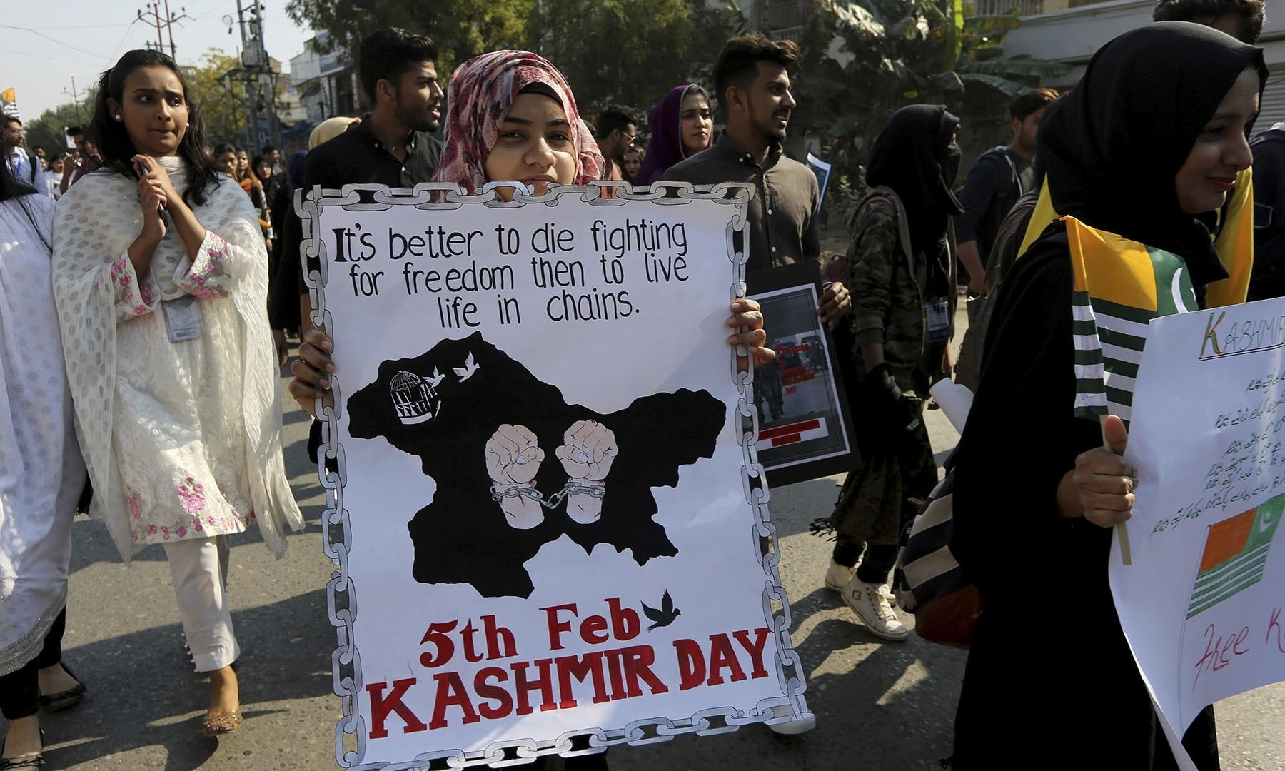 Students take part in a rally in Karachi to express solidarity with Kashmiris. — AP