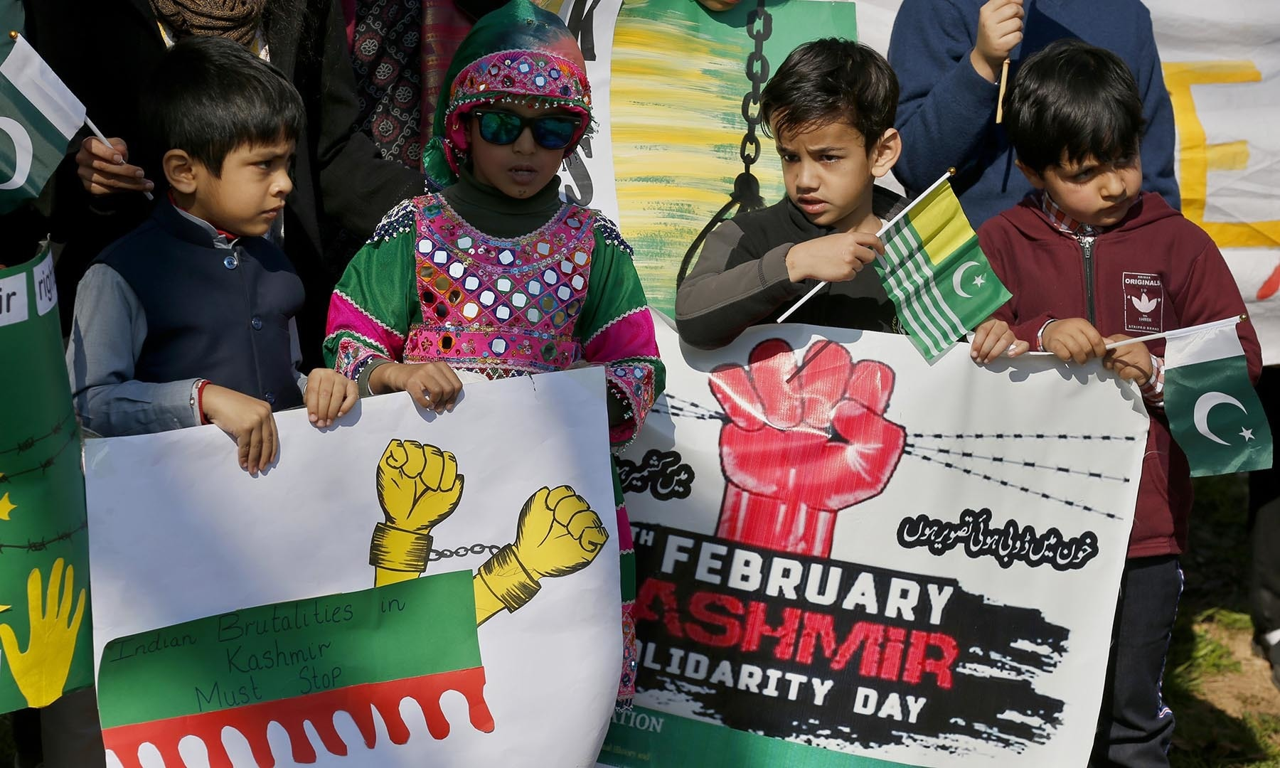 Children take part in a rally in Islamabad to express solidarity with Kashmiris. — AP