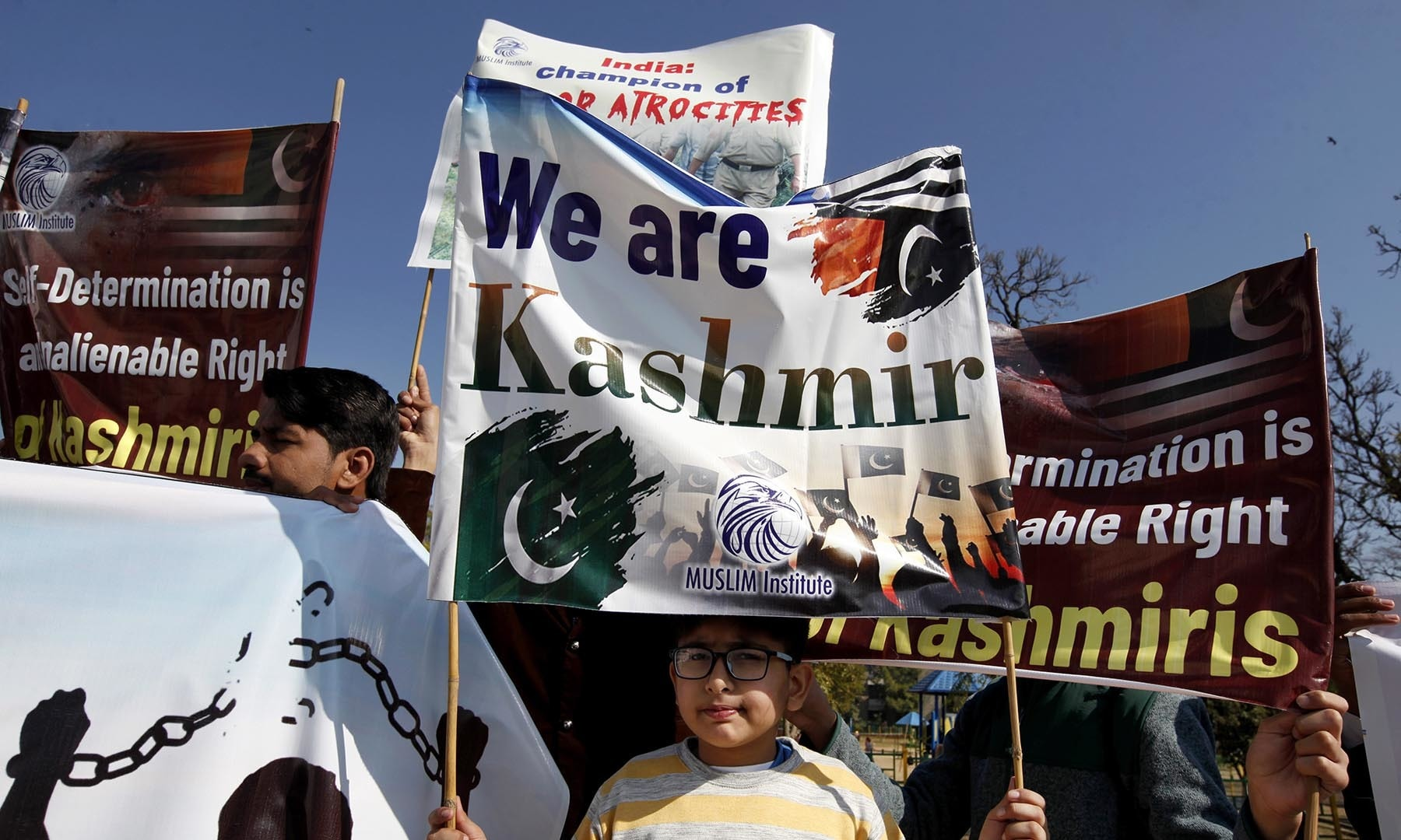 Youngsters take part in a rally in Islamabad to express solidarity with Kashmiris. — AP