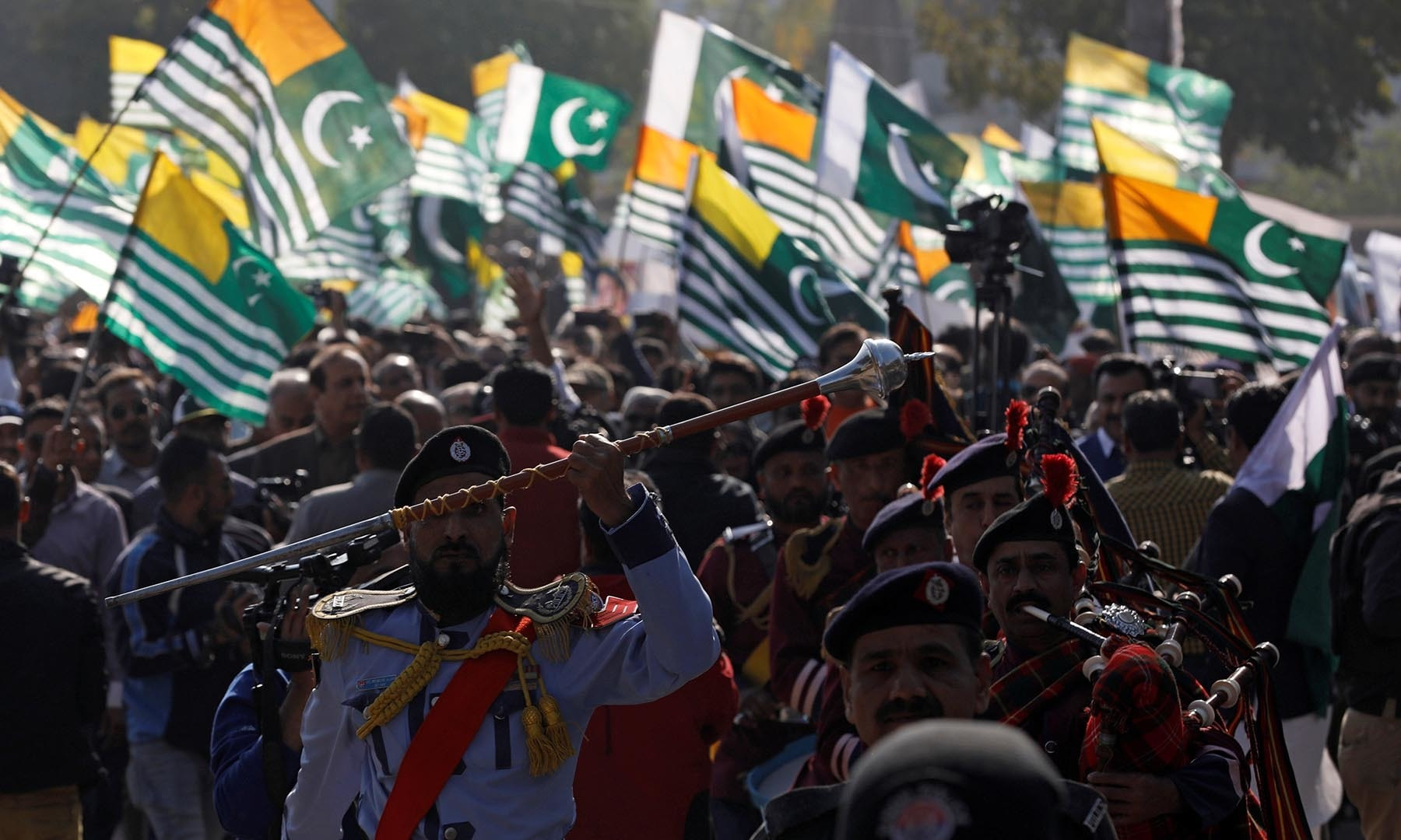 Members of a police band lead a march to mark Kashmir Solidarity Day at the mausoleum of Mohammad Ali Jinnah, in Karachi. — Reuters