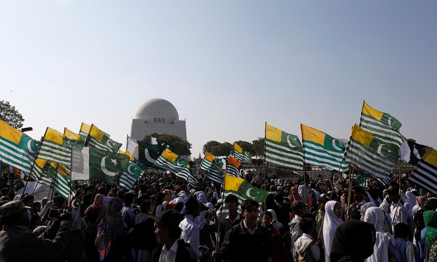 People carry flags as they gather to mark Kashmir Solidarity Day at the mausoleum of Quaid-i-Azam Mohammad Ali Jinnah in Karachi on February 5, 2020. — Reuters