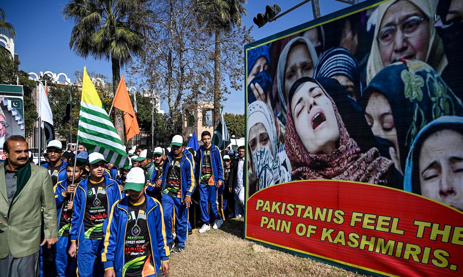 Protesters march during a demonstration to mark Kashmir Solidarity Day in Islamabad. — AFP