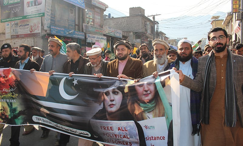 People march during a Kashmir Solidarity Day rally in Bisham, Shangla. — Photo by Umar Bacha