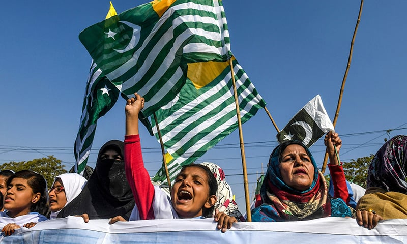 Protesters hold Kashmiri flags as they gather in front of the mausoleum of Quaid-i-Azam Muhammad Ali Jinnah during a demonstration to mark Kashmir Solidarity Day in Karachi on Wednesday. — AFP