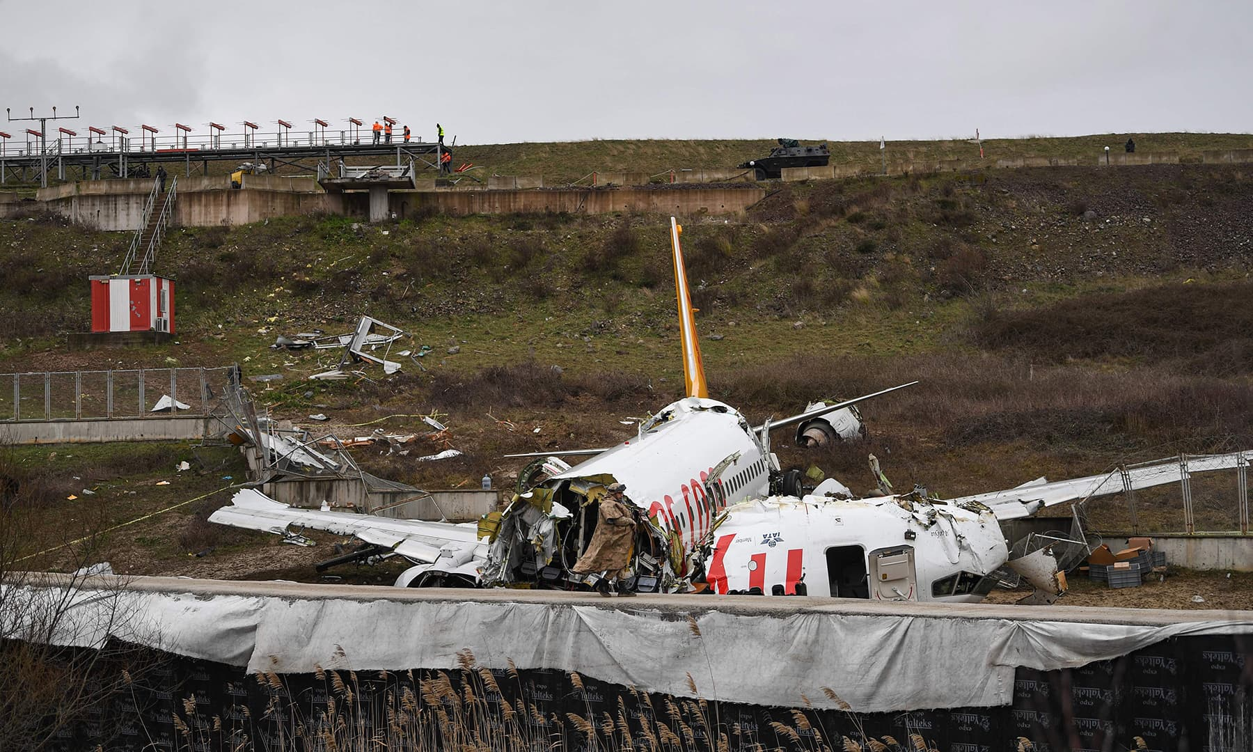 A Turkish soldier stands guard at the site after a Pegasus Airlines Boeing 737 airplane skidded off the runway upon landing at the Sabiha Gokcen airport in Istanbul on Feb 6. — AFP