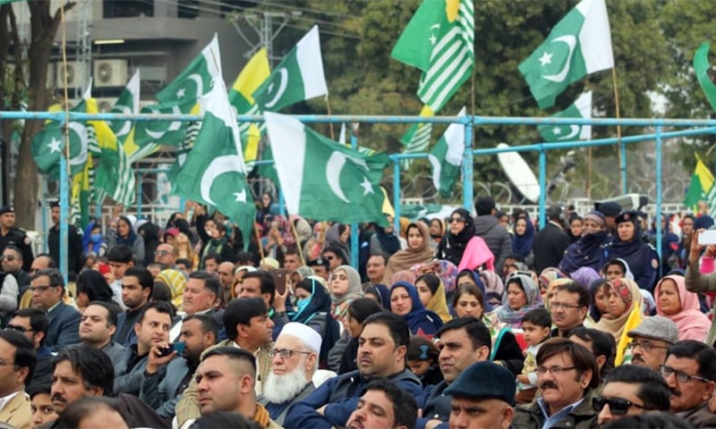 Rally participants listening to the premier's address in Mirpur on Thursday. — Photo courtesy PM Office Twitter