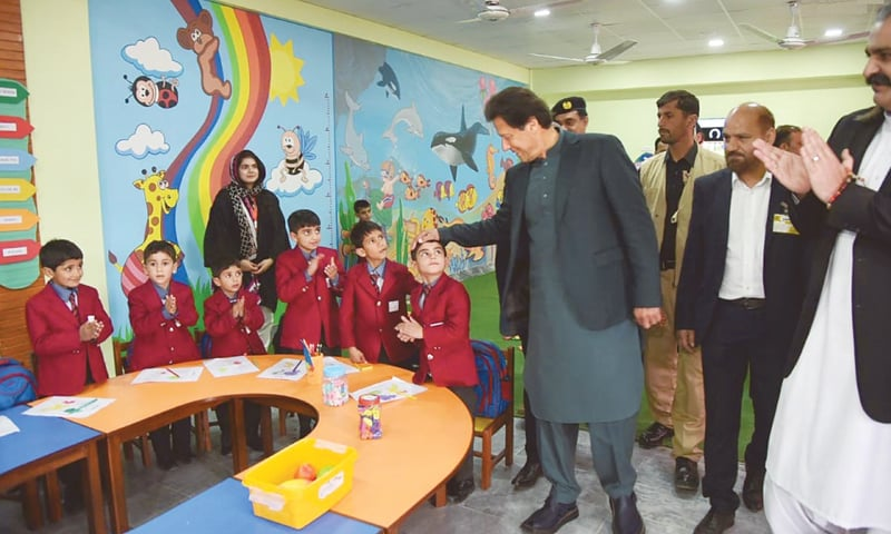 MIRPUR: Prime Minister Imran Khan meets students after inaugurating an educational institute on Thursday.—INP