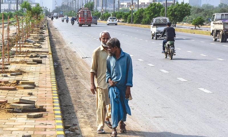 Men walk down Mai Kolachi Road in this file photo.—White Star