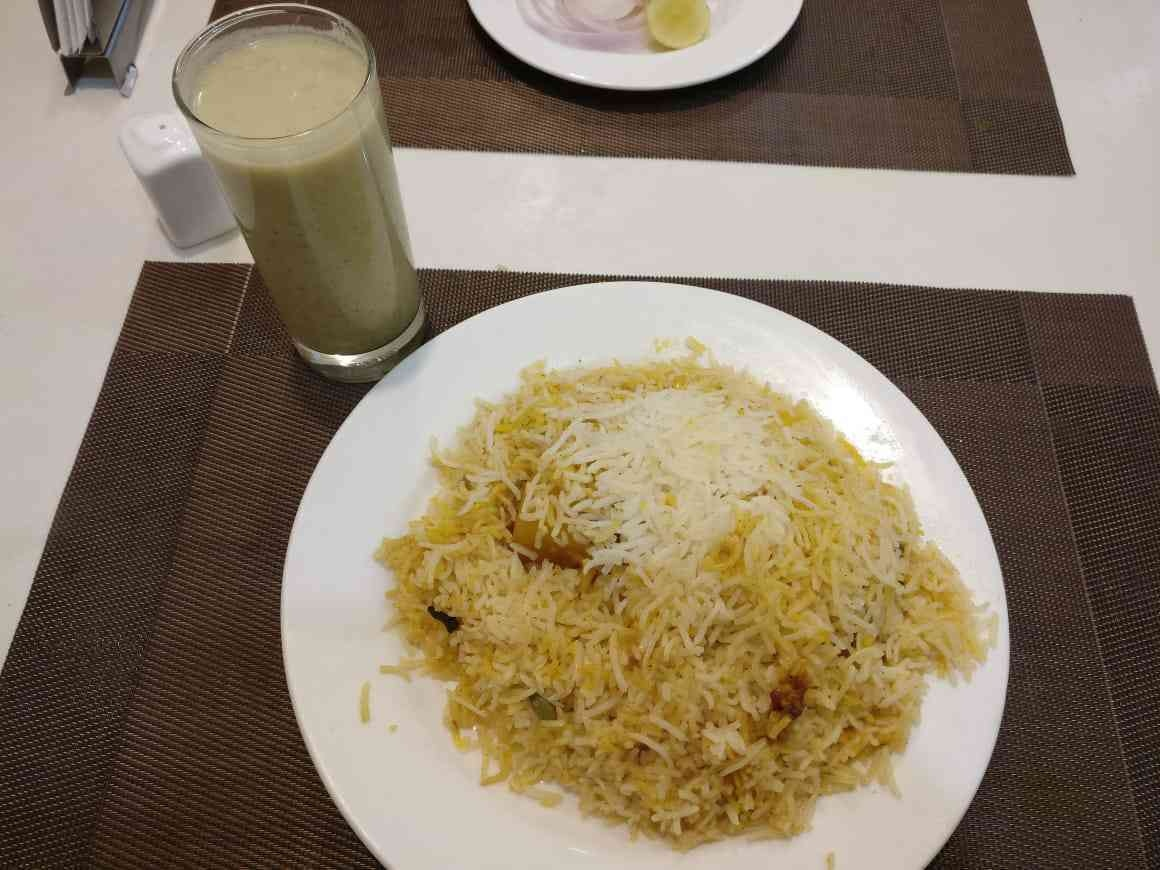 Biryani and yoghurt ghol at Kolkata's Zam Zam.