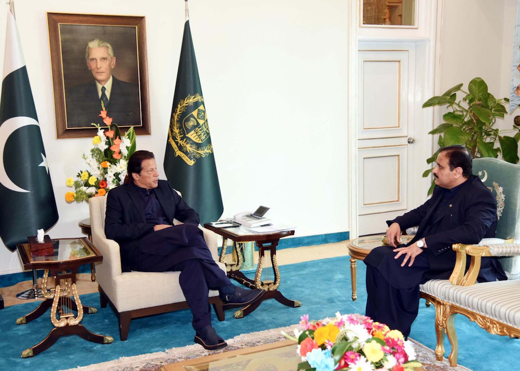 Prime Minister Imran Khan exchanging views with Sardar Usman Buzdar, chief minister of Punjab, at a meeting in Islamabad | PPI Images