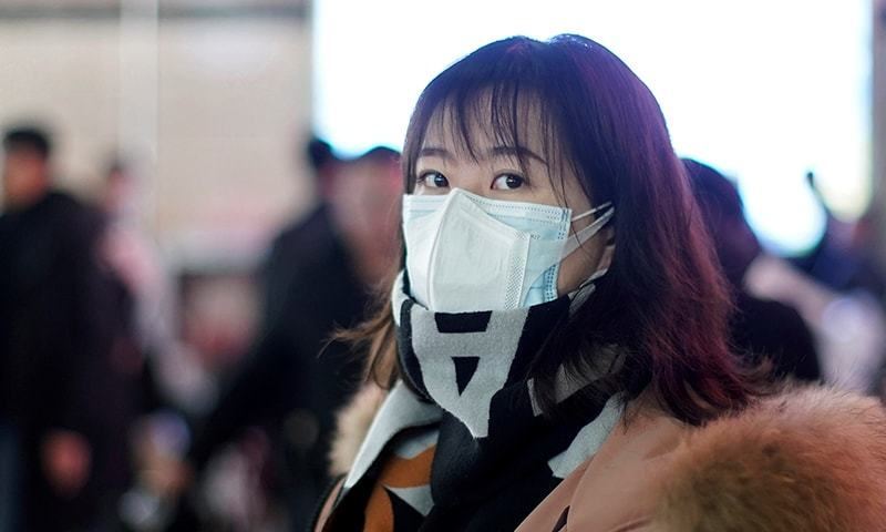A passenger wears a mask at Shanghai railway station in Shanghai, China on January 22. — Reuters/File