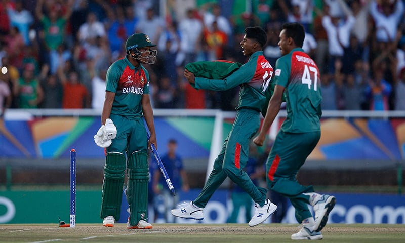 Bangladesh's Rakibul Hasan (L) celebrates with teammates after their victory over India during the ICC Under-19 World Cup cricket finals between India and Bangladesh at the Senwes Park, in Potchefstroom, on February 9, 2020. — AFP