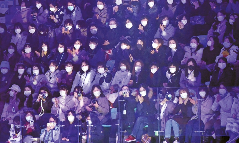 SEOUL: Spectators wear face masks to help prevent the spread of the coronavirus as they watch a skating gala on Sunday. South Korea has confirmed 27 cases of the virus so far.—AFP