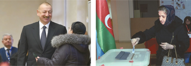 BAKU: Azerbaijan President Ilham Aliyev (left) smiles as he talks to a woman at a polling station on Sunday. A woman votes (right) at a polling station.—Agencies