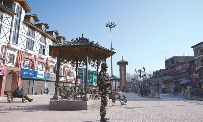 SRINAGAR: An Indian soldier stands guard at a square during the strike on Sunday.—AFP