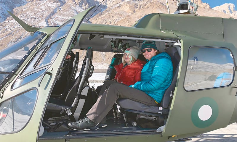 this photo released by the ISPR shows mountaineers Donald Allen Bowie and Lotta Henriikka Nakyva sitting in a helicopter after being rescued on Sunday.