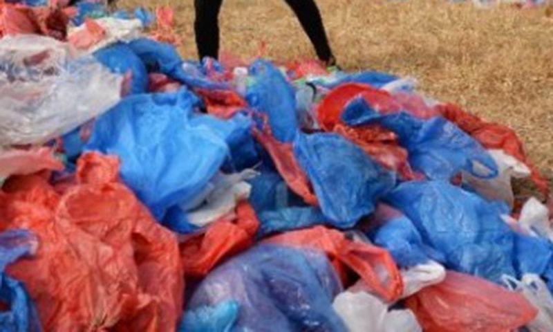 Seized bags would be recycled into more than 1,000 bins and flowerpots. — DawnNewsTV/File