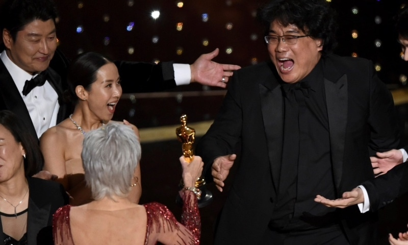 Bong Joon Ho (right) receiving the Best Picture award —Credit: AP