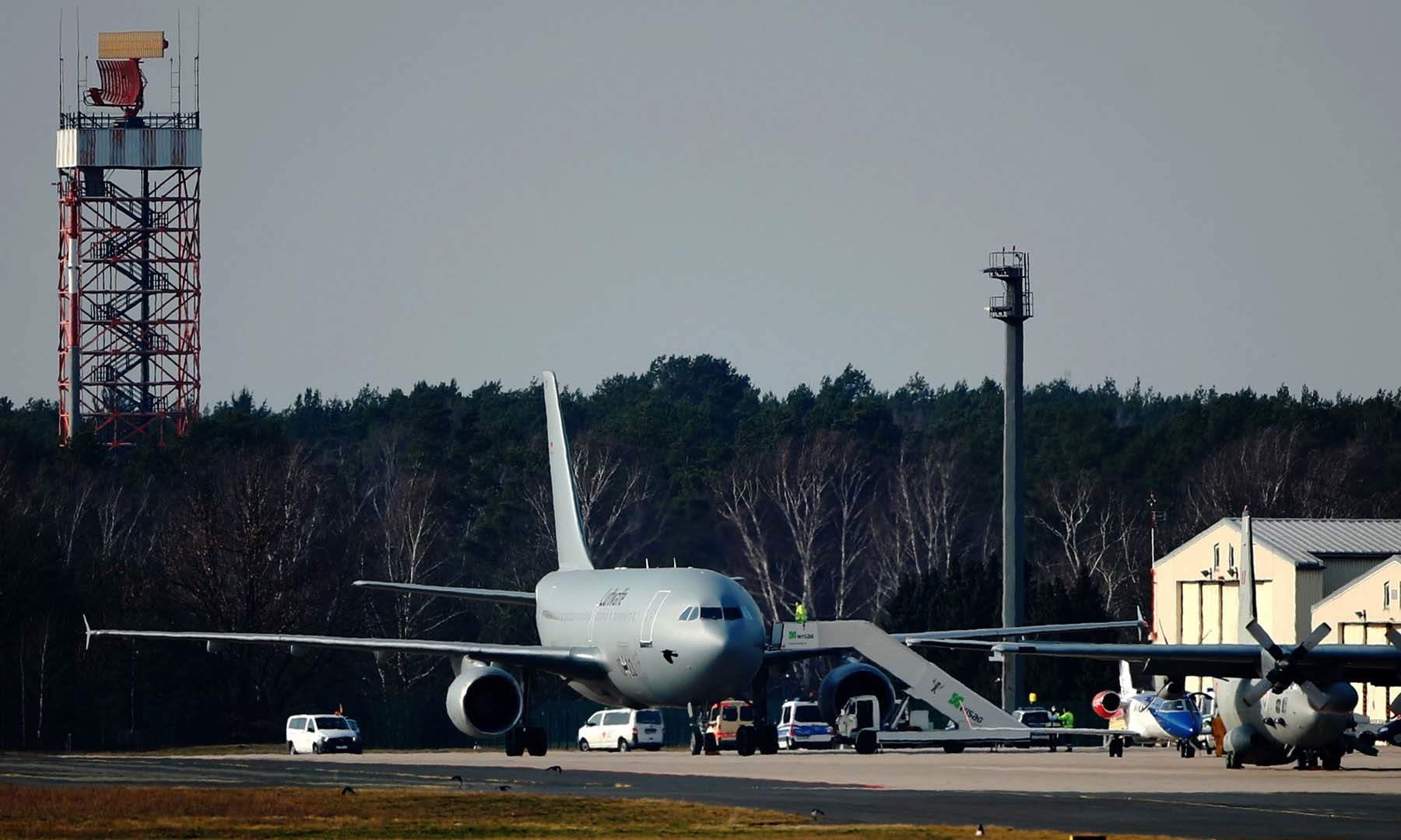 A plane of the German Air Force (Bundeswehr) with twenty Germans from the Chinese city of Wuhan, which is particularly affected by the corona virus, lands in Berlin-Tegel on February 9. — AFP