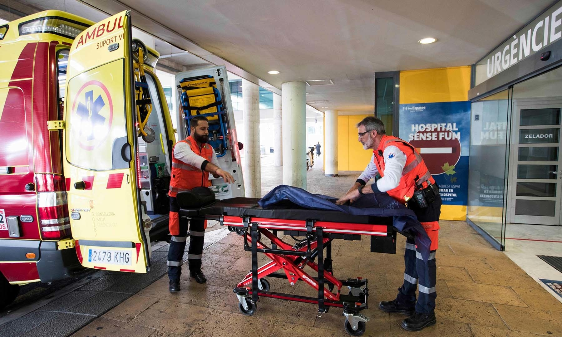 Two men ready an ambulance outside the Son Espases University Hospital in Palma de Mallorca where a British man has been diagnosed with coronavirus, on February 9. — AFP