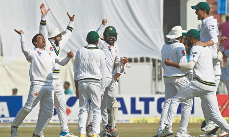 RAWALPINDI: Pakistan players celebrate after the dismissal of Bangladesh batsman Liton Das during the first Test at the Pindi Cricket Stadium on Monday.—Tanveer Shahzad/White Star