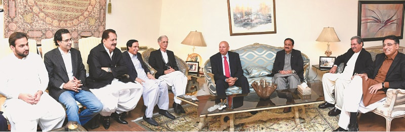 lahore: Punjab Governor Chaudhry Sarwar, Chief Minister Usman Buzdar, federal Education Minister Shafqat Mahmood, Defence Minister Pervez Khattak and Planning and Development Minister Asad Umer in a meeting with Punjab Assembly Speaker Chaudhry Pervaiz Elahi and other members of the Pakistan Muslim League-Quaid on Monday.