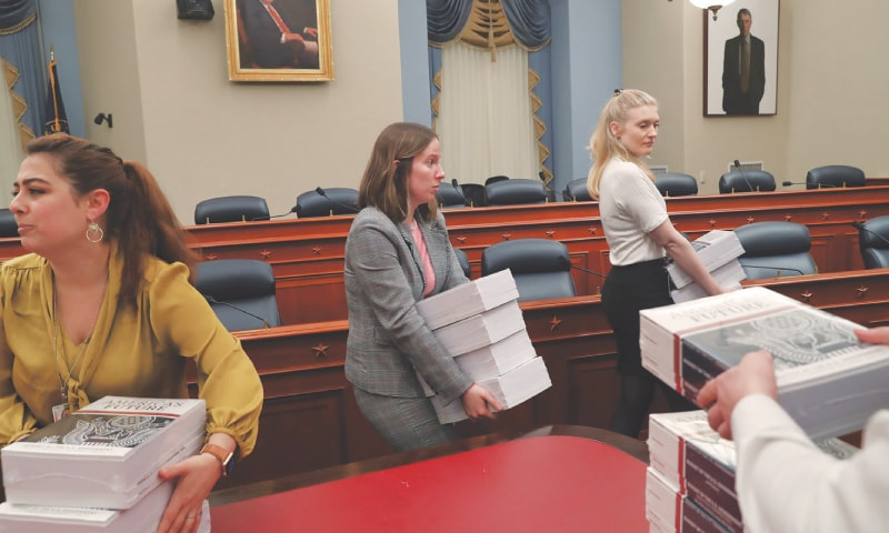 Washington: Staff from the House Budget Committee handle copies of US President Donald Trump's FY2021 budget proposal that were placed on display for the news media on Monday.—Reuters