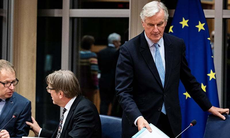 European Union's chief Brexit negotiator Michel Barnier (R) arrives for a meeting at the European Parliament in Brussels, on October 16, 2019. (Photo by Kenzo TRIBOUILLARD / AFP) — AFP or licensors