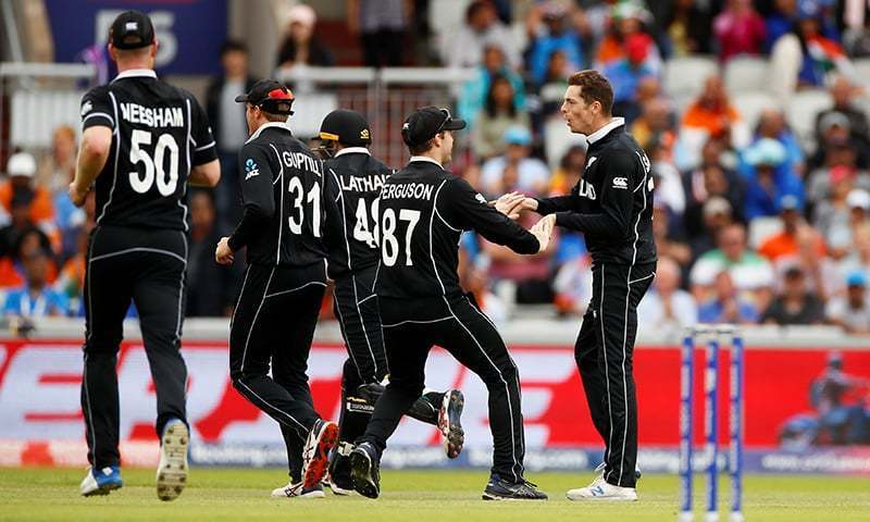 Cricket - ICC Cricket World Cup Semi Final - India v New Zealand - Old Trafford, Manchester, Britain - July 10, 2019   New Zealand's Mitchell Santner celebrates with team mates after taking the wicket of India's Hardik Pandya    Action Images via Reuters/Jason Cairnduff