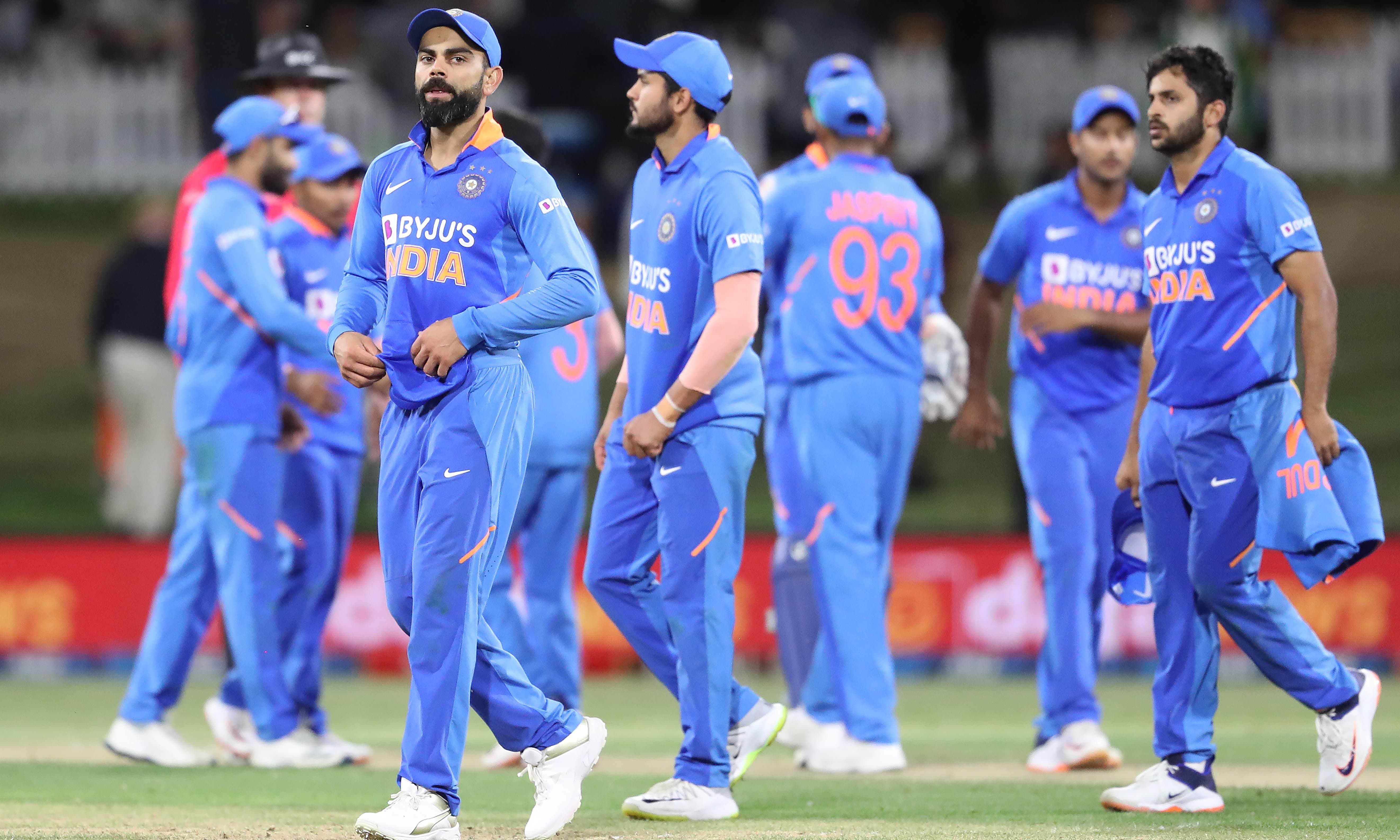 India's Virat Kohli walks with his players off the field after defeat during the third one-day international cricket match between New Zealand and India at the Bay Oval in Mount Maunganui on Feby 11. — AFP