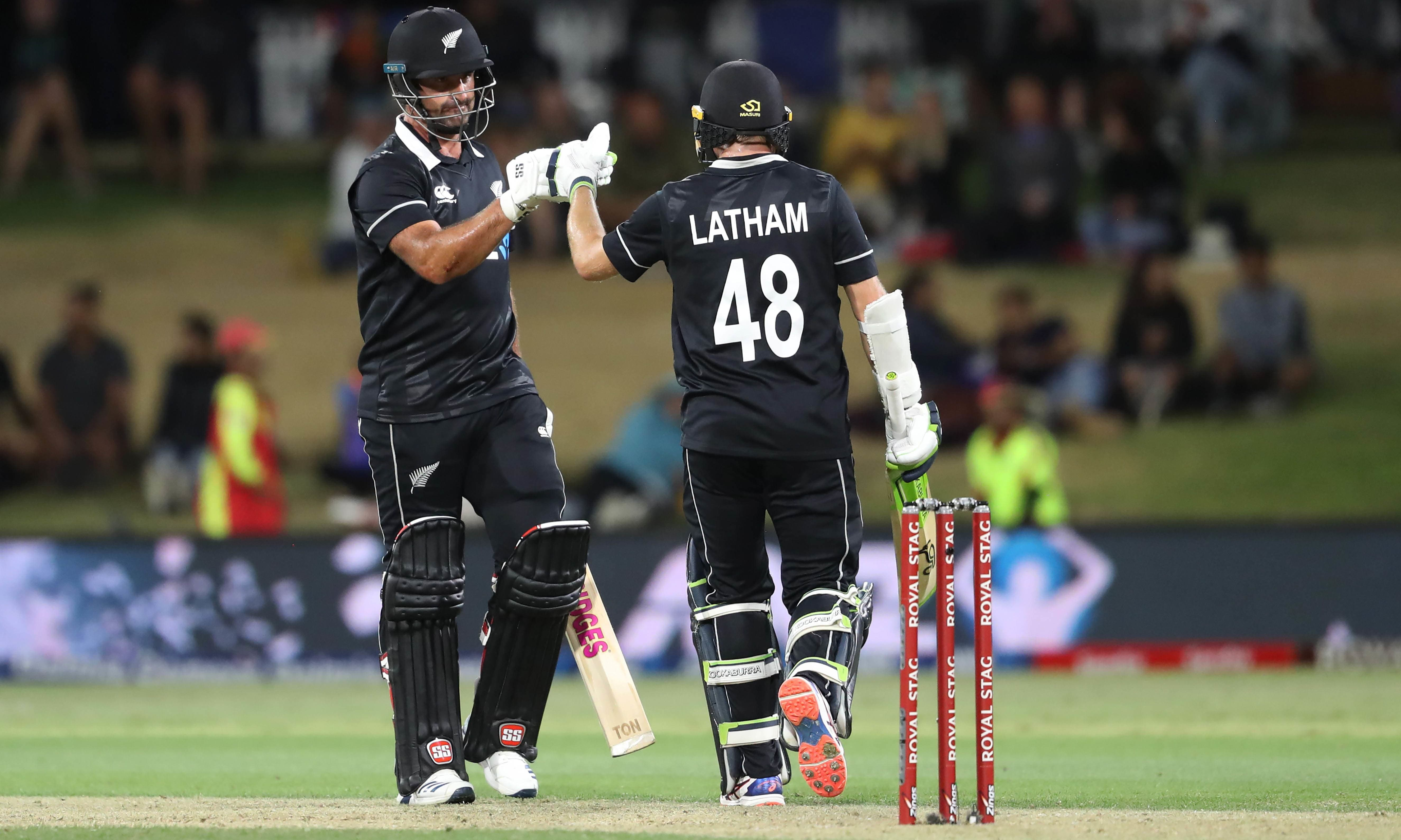 New Zealand's Colin de Grandhomme (L) and Tom Latham react during the third one-day international cricket match between New Zealand and India at the Bay Oval in Mount Maunganui on Feb 11. — AFP