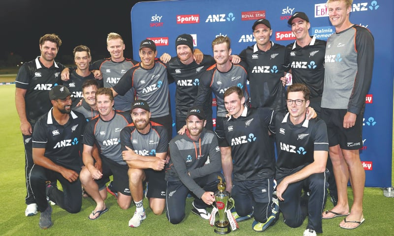 MEMBERS of New Zealand squad celebrate with the trophy after recording the ODI clean sweep against India at the Bay Oval on Tuesday.—AFP
