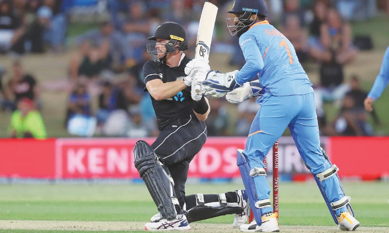 NEW ZEALAND opener Martin Guptill plays a stroke as Indian wicket-keeper KL Rahul looks on.—AFP