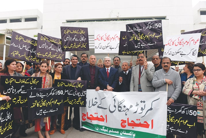 ISLAMABAD: Members of parliament from the Pakistan Muslim League-Nawaz hold a protest against price hike outside the Parliament House on Tuesday.—Mohammad Asim / White Star