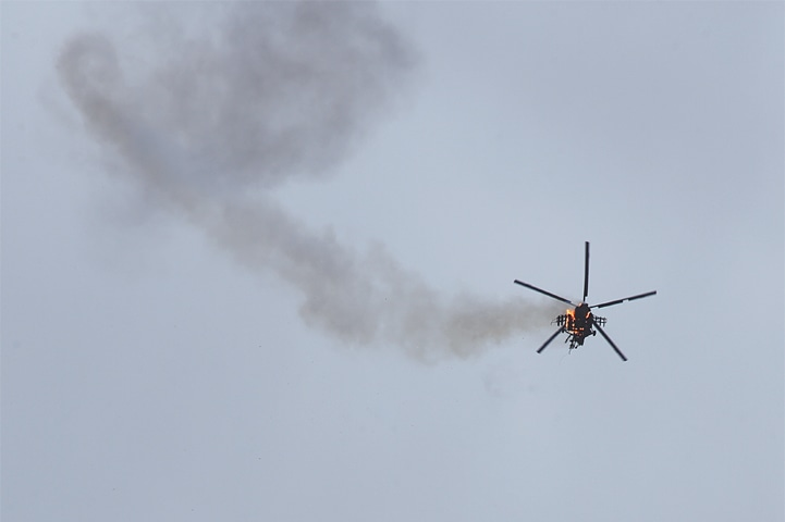 The Syrian helicopter pictured after it was struck by a missile.—AP