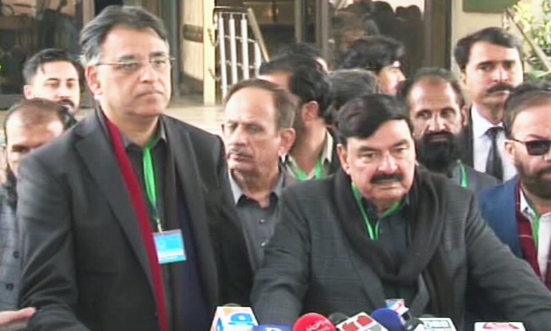 Minister for Planning, Development and Special Initiatives Asad Umar and Minister for Railways Sheikh Rashid Ahmed speak to the media outside the Supreme Court in Islamabad on Wednesday. — DawnNewsTV