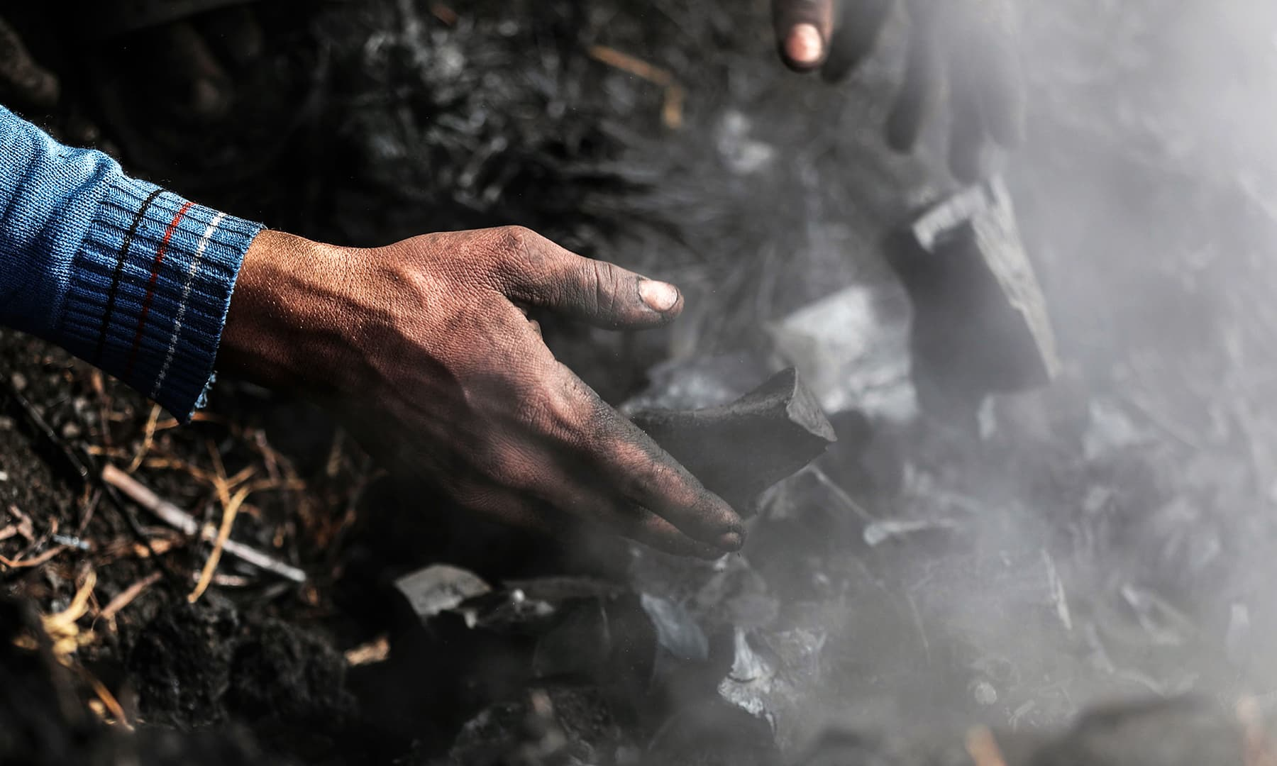 An Egyptian labourer works at a charcoal factory in Egypt's Sharkia governorate. — AFP
