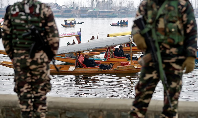 Foreign diplomats are seen in boats as Indian security personnel stand guard on the banks of Dal Lake in Srinagar, February 12. — Reuters