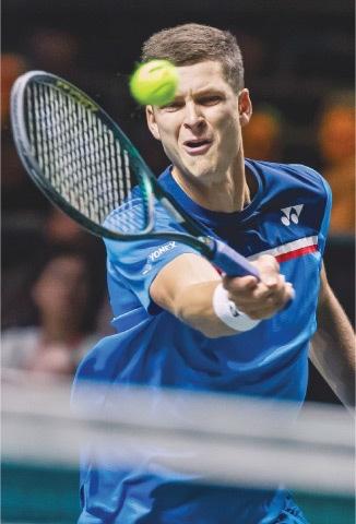 HUBERT Hurkacz of Poland plays a return to Greece's Stefanos Tsitsipas during their Rotterdam Open match.—AFP