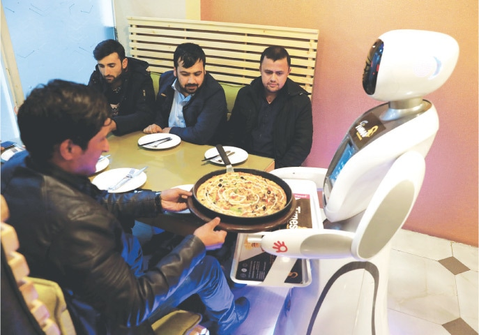 Kabul: The waitress robot delivers food to customers at the Times Fast Food restaurant.—Reuters
