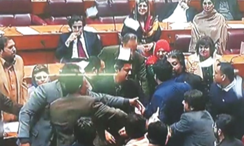 THIS DawnNews TV grab shows protesting lawmakers, mainly belonging to the Pakistan Peoples Party, gather near treasury benches during the speech of Energy Minister Omar Ayub Khan.